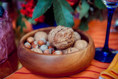 Wooden bowl of walnuts and hazelnuts Royalty Free Stock Image