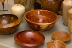 Wooden Bowls. Various shaped and colored wooden bowls sit on display Royalty Free Stock Images