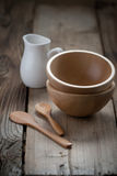Wooden Bowls And A Small Jug On The Wooden Background Stock Image