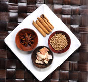 Wooden bowls of different spices Stock Images