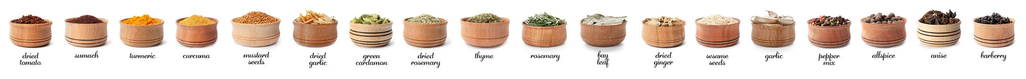 Wooden bowls with different spices and herbs on white background. Large collection with names stock images