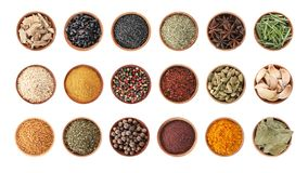 Wooden bowls with different spices and herbs on white background, top view. Large collection stock photo