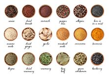 Wooden bowls with different spices and herbs on white background, top view. Large collection with names stock photography
