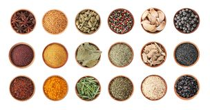Wooden bowls with different spices and herbs on white background, top view. Large collection stock images