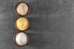 Wooden bowls with different types of flour. On gray background Royalty Free Stock Photos
