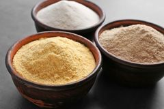 Wooden bowls with different types of flour. On gray background Stock Photos