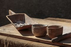 Wooden Bowls and Flour inside Crate on Wooden Plank Royalty Free Stock Photo