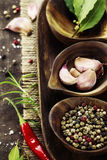 Wooden bowls with fresh herbs and spices stock photos