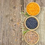 Wooden bowls with lentils and fresh hebs. Wooden bowls with lentils and fresh herbs - wooden background Stock Photography