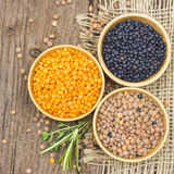 Wooden bowls with lentils Stock Photos