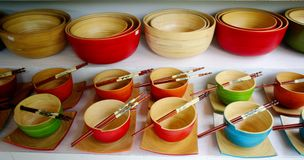 Wooden Bowls. Multiple color wooden bowls with chopsticks Royalty Free Stock Image