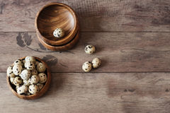 Wooden bowls with quail eggs. Rustic wood background, diffused natural light. A different type of concept image for Easter Stock Image