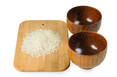 Wooden bowls for rice. Handful Royalty Free Stock Photos