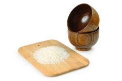Wooden bowls for rice. Handful Royalty Free Stock Photography