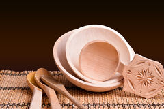 Wooden bowls and spoons on table Stock Photography