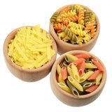 Wooden bowls of tricolor pasta Royalty Free Stock Photos