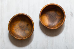Wooden bowls on white table Stock Photography