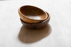 Wooden bowls on white table Stock Images