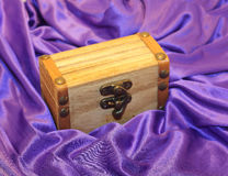 Wooden box. On a purple substance Royalty Free Stock Photos