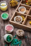 Wooden box with accessories for Spa treatments. Sea aromatic salt for Spa treatments on the background of yellow rose buds Royalty Free Stock Images