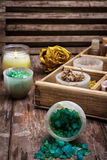Wooden box with accessories for Spa treatments. Sea aromatic salt for Spa treatments on the background of yellow rose buds Royalty Free Stock Photos