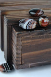 Wooden box and agates Stock Photo