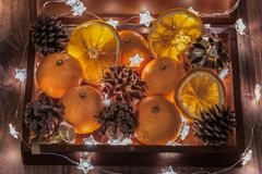 New Year and Christmas mood, New Year`s table decoration, garlands, stars, cones, tangerines stock images