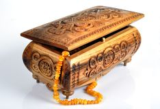Wooden box and amber beads Royalty Free Stock Images