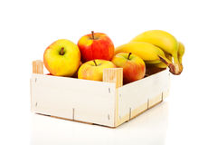 Wooden box of apples and bananas Stock Image