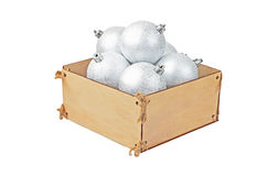 Wooden box with christmas baubles Stock Photography