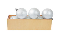 Wooden box with christmas baubles Royalty Free Stock Image