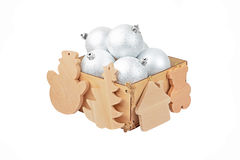 Wooden box with christmas baubles Stock Images