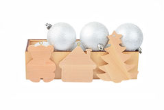 Wooden box with christmas baubles Royalty Free Stock Images