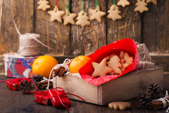 Wooden box with Christmas cookies and gifts. Preparations for ho Royalty Free Stock Images