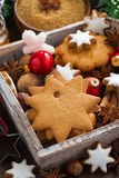 Wooden box with Christmas cookies, spices and decorations Royalty Free Stock Image