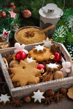 Wooden box with Christmas cookies, spices and decorations Royalty Free Stock Images