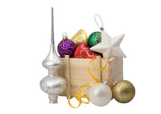 Wooden box with christmas decorations Royalty Free Stock Photos