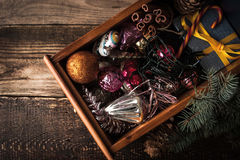 Wooden box with Christmas decorations and gift top view Stock Photo