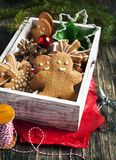 Wooden box with Christmas gingerbread cookies and ornaments Stock Photos
