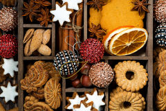 wooden box with Christmas sweets, nuts and spices, closeup Stock Photos