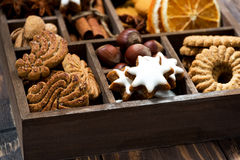 wooden box with Christmas sweets and spices on wooden background Stock Images