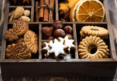 Wooden box with Christmas sweets and spices on wooden table Royalty Free Stock Image