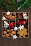 Wooden box with Christmas symbols and spruce branches, top view. Vertical, close-up Royalty Free Stock Images