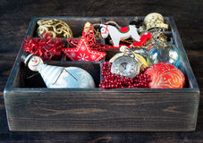 Wooden box with Christmas toys, gifts and decorations Royalty Free Stock Image