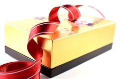 Wooden box and cloth ribbon Royalty Free Stock Photography