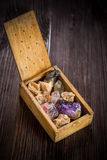 Wooden box with collection of rocks and minerals Royalty Free Stock Photos