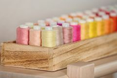Wooden box with color sewing threads. Closeup Royalty Free Stock Photo