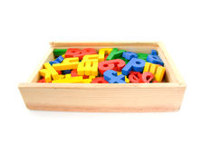Wooden box with colorful letters Stock Photos