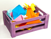 Wooden box of colorful origami. Purple wooden box of colorful handmade origami Royalty Free Stock Photography