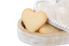 Wooden box with cookies in the form of heart, isolated Stock Image